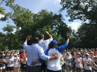 Democratic Senate hopeful Beto O'Rourke waves to supporters at Opportunity Park in South Dallas with state Rep. Eric Johnson (left) and state District Judge Staci Williams (right).(Gromer Jeffers Jr.)