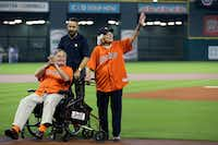 Former President George H.W. Bush along with wife Barbara prepares to throw out the ceremonial first pitch before Game 3 of baseball's American League Division Series between the Kansas City Royals and Houston Astros in 2015.(Pat Sullivan/AP)