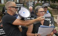 Todd Whitley held the bullhorn microphone for Susybelle Lyons Gosslee as faith leaders and concerned citizens gathered on the front steps of the Frank Crowley Courts Building in 2014 to protest the death penalty.(File Photo/Staff)