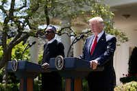 President Donald Trump and Nigerian President Muhammadu Buhari during a joint news conference in the Rose Garden at the White House on April 30, 2018. Trump urged other countries to support the North American bid to host the 2026 World Cup and implied there might be consequences for those who did not.(Tom Brenner/The New York Times)
