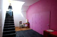 A visitor tours architect Luis Barragan's home, 2004, in Mexico City. More than 10,000 people come each year to tour the house, restored after Barraga's death in 1988.(Jose Luis Magana/The Associated Press)
