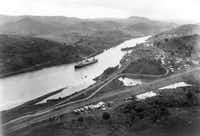 This Aug. 15 , 1914, file photo shows the New York-registered SS Ancon crossing the Culebra cut of the Panama Canal on opening day, as seen from Cerro Luisa, looking north.(AFP/Getty Images)