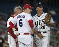 From left: Rep. Todd Platts, R-Pa., manager Joe Barton, R-Texas, and pitcher John Shimkus, R-Ill., conferred on the mound during the 49th annual Congressional Baseball Game at Nationals Stadium in Washington on June 29, 2010.(Bill Clark/Roll Call Photos)