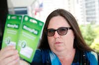 "Jennifer Smallwood holds the pre-paid cards valued at $400 that her husband was about to pay a ""kidnapper"" as ransom to save her. (Vernon Bryant/Staff Photographer)"