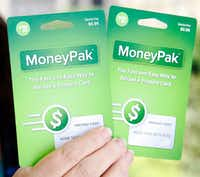 These MoneyPak prepaid cards, and other cards like them available at retail stores, are a favored method by scammers to extract money from victims. They are hard to trace.(Vernon Bryant/Staff Photographer)