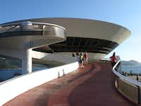 Visitors check out the distinctive Museum of Contemporary Art October 15, 2006, in Niteroi, Brazil. Legendary Brazilian architect Oscar Niemeyer designed the museum, which has become one of his most popular projects.(Jack Chang/MCT)