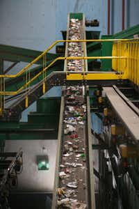 Recycled material moves on a conveyor belt to be sorted at the Dallas recycling facility. China has stopped allowing the import of recyclable goods from many countries including the United States, and these nations are struggling with excess amounts of recyclables with nowhere to send it.(Rose Baca/Staff Photographer)
