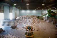 Recyclable material is piled on the tipping floor ready to be sorted at the Dallas recycling facility.(Rose Baca/Staff Photographer)