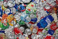 Aluminum cans are baled at the Dallas recycling center.(Rose Baca/Staff Photographer)