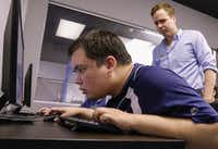 <p>Kyle Barton (right), an instructor at the nonPareil Institute in Plano, works with Iain Morrison during a beginning design course at the institute. NonPareil is a Plano-based nonprofit that teaches adults with autism job skills such as coding and video game design.</p>(Ron Baselice/Staff Photographer)