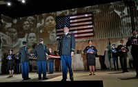 Nathan Stark (center) as the Judge in the world premiere of Huang Ruo and David Henry Hwang's <i>An American Soldier</i>. (Ken Howard/Opera Theatre of Saint Louis)