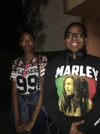 Sisters Ebony Thomas and Trinity Thomas (wearing a Bob Marley shirt) share thoughts about 'The Lion King' national tour, presented by Dallas Summer Musicals, after the Thursday, June 14 performance at Fair Park Music Hall. The show continues through July 8.(Nancy Churnin)