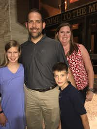 Parents Angela and Brad Chaney and children Peyton Chaney, 12, and Connor Chaney, 8, from Allen share thoughts about&nbsp; <i>The Lion King</i>.(Nancy Churnin)