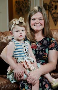 Jessica Hitt and her daughter, Olivia, 2,  recently posed for a photo at their home in Arlington. A UT Southwestern clinical genetics specialist helped her overcome a serious genetic disorder and move on with her life. (Brandon Wade/Special Contributor)