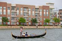"<p>The gondola cruises past <span style=""font-size: 1em; background-color: transparent;"">apartment complexes and construction sites</span><span style=""font-size: 1em; background-color: transparent;""> on Lake Carolyn in Irving.</span></p>(Jae S. Lee/Staff Photographer)"