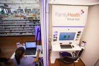 Children's Health virtual health project coordinator Vanessa Hawkins works beside the Family Health Virtual Visit kiosk in the flagship Dougherty's Pharmacy in Preston Royal Village.(Smiley N. Pool/Staff Photographer)