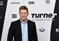 Turner CEO John Martin said the AT&T merger could speed up Turner's growth — but he said he's not impressed by the telecom company's current entertainment offerings. (Evan Agostini/Invision/The Associated Press)