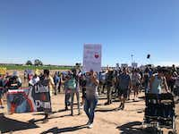"<br>(<p><span style=""font-size: 1em; background-color: rgb(255, 255, 255);"">Marchers </span><span style=""font-size: 1em; background-color: transparent;"">protest the Trump administration's policy of separating children from their parents as families arrive at the nation's southern border. (Alfredo Corcahdo/Dallas Morning News)</span></p>)"