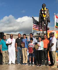 <p>Mahatma Gandhi Memorial officials presented plaques and ribbons to the top three winners of the 2018 Scripps National Spelling Bee who posed with their fathers on Father's Day at the memorial in Irving. The winners are Karthik Nemmani (fourth from left), Abhijay Kodali (with red folder) and Naysa Modi. (Deborah Fleck/Staff)</p><p></p>
