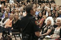 "<p>Bianez often speaks at crime prevention seminars, such as this one that the Plano Police Department held in 2014. ""He's so popular and personable, and he does a great presentation,"" says Jill Church, who's heard him four times.</p>(Andy Jacobsohn/Staff Photographer)"