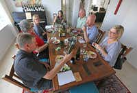 The wine panel at work.(Louis DeLuca/Staff Photographer)