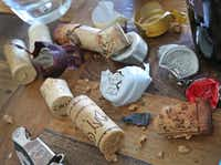 The table becomes cluttered with corks and wrappings from old wine bottles.(Louis DeLuca/Staff Photographer)