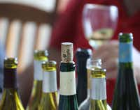 Wine bottles sit open on the table(Louis DeLuca/Staff Photographer)