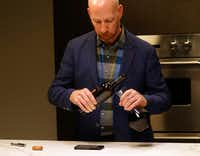 James Tidwell demonstrates how to position your hands and tools to decant.(Vernon Bryant/Staff Photographer)