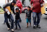 Young immigrants arrive with their parents at the Catholic Charities Rio Grande Valley after they were processed and released by U.S. Customs and Border Protection on Tuesday, June 19, 2018, in McAllen. (Eric Gay/The Associated Press)
