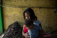 """Yolanda Lopez, who fled to Mexico from El Salvador, fearing for her children's safety, in Tapachula, Mexico. In Mexico, she heard about the Trump administration's policy of separating children from their parents at the border. """"What bad luck,"""" she said.(ALEJANDRO CEGARRA/NYT)"""