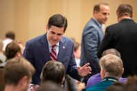 Russell Moore talks with people in the audience before a panel at the Southern Baptist Convention annual meeting at the Omni Hotel on Monday, June 11, 2018, in Dallas.(Smiley N. Pool/Staff Photographer)