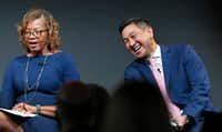 Alfreda Norman of the Federal Reserve Bank of Dallas shares a laugh with George Tang, managing director of Educate Texas, during a panel discussion on STEM education and workforce development, held at Toyota North American Headquarters in Plano.(Louis DeLuca/Staff Photographer)