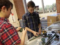 Tyler Gassman (left) and Connor Redding work on a project in a robotics class at Lovejoy High School in Lucas. (2016 File Photo)