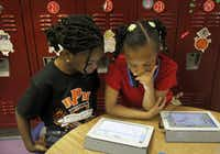 Kindergarten students at Rosa Parks-Millbrook Elementary School in Lancaster worked with lessons on their NOOK. (2014 File Photo/Staff )