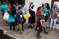 Sister Norma Pimentel welcomes a group of young immigrants and their families as they arrive after a walk from the bus station to the Catholic Charities RGV Humanitarian Respite Center after being processed and released by U.S. Customs and Border Protection on Wednesday, June 20, 2018, in McAllen.(Smiley N. Pool/Staff Photographer)