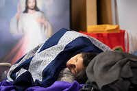 A woman sleeps at the Catholic Charities Humanitarian Respite Center after being processed and released by U.S. Customs and Border Protection.(Staff Photographer/Smiley N. Pool)