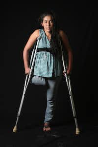 "<p>&nbsp;Undocumented Guatemalan immigrant Elvira Lopez, 22, stands on crutches at the Jesus el Buen Pastor shelter on July 31, 2013 in Tapachula, Mexico. She fell under the wheels of a freight train and lost her right leg while on route to the United States.&nbsp; The image appears in&nbsp;<span style=""font-size: 1em; background-color: transparent;""><i>Undocumented: Immigration and the Militarization of the United States-Mexico Border.</i></span></p><p></p>(John Moore/Getty Images)"