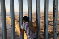 "<p>&nbsp; A man looks through the U.S.-Mexico border fence into the United States on September 25, 2016 in Tijuana, Mexico. Friendship Park on the border is one of the few places on the 2,000-mile border where separated families are allowed to meet.&nbsp;&nbsp;<span style=""font-size: 1em; background-color: transparent;"">The image appears in</span><i style=""font-size: 1em; background-color: transparent;""> Undocumented: Immigration and the Militarization of the United States-Mexico Border.</i></p>(John Moore/Getty Images)"