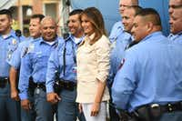 Melania Trump poses with McAllen police officers during a visit to the Upbring New Hope Children's Center.(Mandel Ngan/Agence France-Presse)