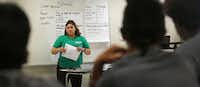 Amanda Mendoza talked with students last year during a sex education class for kids in Vickery Meadows, run by the North Texas Alliance to Reduce Unintended Pregnancy in Teens.(Louis DeLuca/Staff Photographer)
