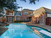 Dr. Kelly Robinett's attorney said his client's former business partner, Shawn Chamberlain, owned this Frisco house and lived a lavish lifestyle from the proceeds of his fraud.