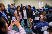 Gubernatorial candidate Lupe Valdez, center, poses for photos with delegates during the Texas Democratic Convention on Friday, June 22, 2018 at the Fort Worth Convention Center in Fort Worth.(Ashley Landis/Staff Photographer)
