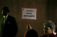 "Linda Evans holds up a sign that reads ""I STAND #WITH REFUGEES"" during a protest among refugee advocates in Thanks-Giving Square in downtown Dallas on Nov. 13, 2017.(Andy Jacobsohn/Staff Photographer)"