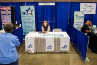 Volunteer Elizabeth Anderson mans a Democrats for Life of America booth during the Texas Democratic Convention on Saturday, June 23, 2018 at the Fort Worth Convention Center in Fort Worth. (Ashley Landis/Staff Photographer)