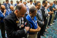M. Emad Salem prays with other members of the Muslim caucus during the Texas Democratic Convention on Friday, June 22, 2018 at the Fort Worth Convention Center in Fort Worth. (Ashley Landis/Staff Photographer)