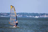 A man windsurfs at Windsurf Bay Park, at Lake Ray Hubbard in Garland. (Carly Geraci/The Dallas Morning News)(Carly Geraci/Staff Photographer)