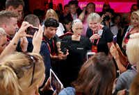 Attendees take photos of and with humanoid robot Sophia during the Impact 2018 digital economy forum on June 13, 2018 in Krakow, Poland.(Tomasz Wiech/AFP/Getty Images)