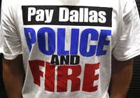 Dallas police officers, first responders and their supporters attended a meeting at Dallas City Hall asking for a raise on Aug. 3, 2016. (David Woo/Staff Photographer)