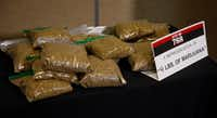 Bags of oregano sit on a table as a representation of what four pounds of marijuana would look like, the amount that would be allowed under SQ788, during a news conference against SQ788 in Oklahoma City, Wednesday, June 20, 2018. Oklahoma's State Question 788, the result of an activist-led signature drive, would allow physicians to approve medical marijuana licenses for people to legally grow, keep and use cannabis. An opposition group that includes law enforcement, business, political and faith leaders is launching a late campaign to defeat it, saying it's too loosely written. (AP Photo/Sue Ogrocki)(Sue Ogrocki/AP)