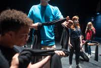 Cara Lawson, a recent graduate of Booker T. Washington High School for the Performing and Visual Art (second from right), is among the teens who will be performing in Cry Havoc's <i>Babel</i>,  a docudrama about gun violence that she and the company helped create.(Rex C Curry/Special Contributor)